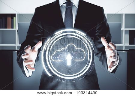 Businessman holding upload cloud in office interior. Internet concept. 3D Rendering