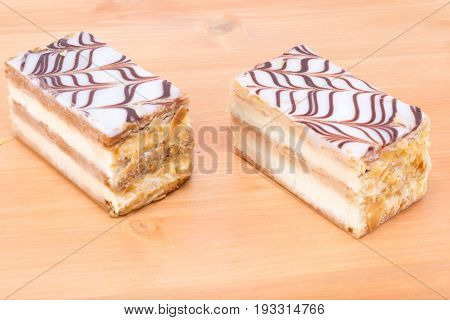 Two Delicious Mille Feuille Napoleon French Custard Pastry On A Oak Wood Table