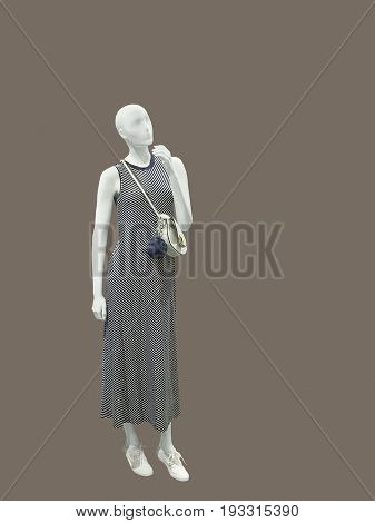 Full-length female mannequin wearing sleeveless dress. No brand names or copyright objects.