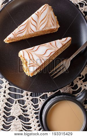 Traditional Sliced Cake Eszterhazy And Coffee With Milk Close-up On The Table. Vertical Top View