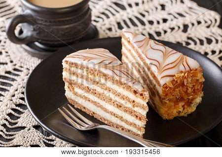 Esterhazy Cake Decorated With Cobwebs And Coffee With Milk Close-up. Horizontal