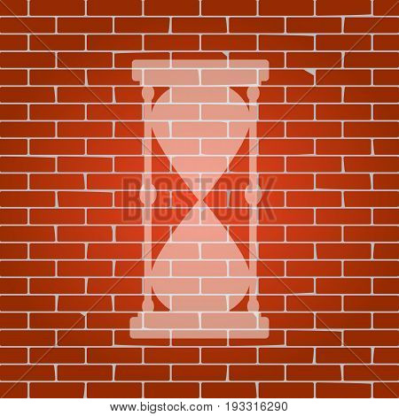 Hourglass sign illustration. Vector. Whitish icon on brick wall as background.