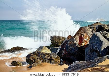 Salty sea water, waves, sun, sand, rocks and holidays summer and heat