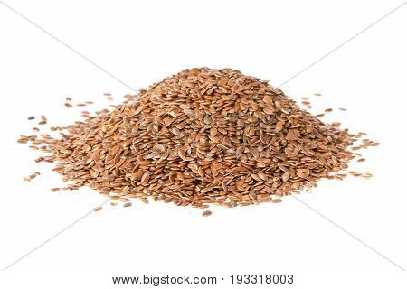 Heap of raw uncooked linseed or flax seed over white background