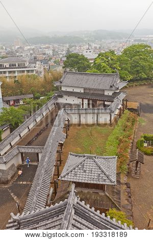 SHIROISHI JAPAN - MAY 25 2017: View of reconstructed Main gate and protective walls of Shiroishi Castle Japan from main keep. Castle was founded in 1591 by Gamo Ujisato and dismantled in 1875