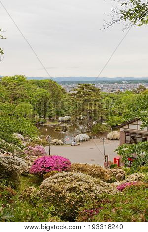 AKITA JAPAN - MAY 26 2017: Park with pond on the grounds of former Kubota Castle in Akita Japan. Castle was founded in 1603 by Satake Yoshinobu destroyed by fire in 19th c