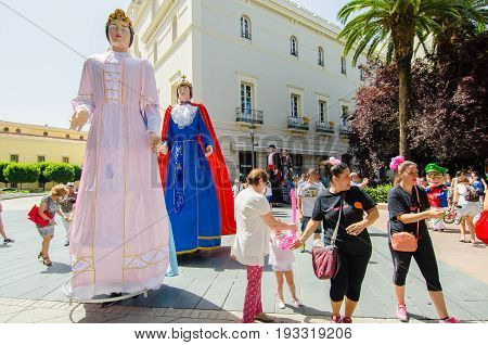 Badajoz, Spain - june 24, 2017: Disguised figures known as giants and big heads,  roughly gigantes y cabezudos parade for the children in the city of Badajoz