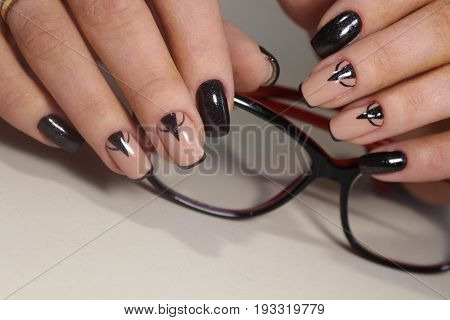 Beautiful Manicure Design And Glasses