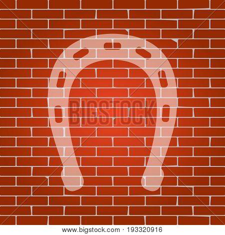 Horseshoe sign illustration. Vector. Whitish icon on brick wall as background.