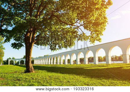 Veliky Novgorod Russia.Architecture landscape with arcade of the medieval Yaroslav's courtyard at sunset in Veliky Novgorod Russia. Russian architecture landmark view in sunny weather poster