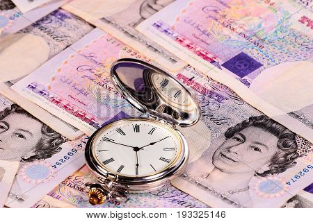 British paper national currency and antique clock as an element of luxury and success