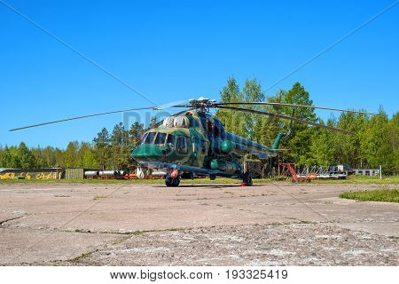 Multipurpose helicopter Mi-8 MT at the airfield in Pushkin during the festive Airshow. Helicopter in camouflage coloring.