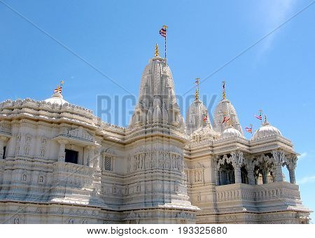 Flags on the towers of Shri Swaminarayan Mandir in Toronto Ontario Canada