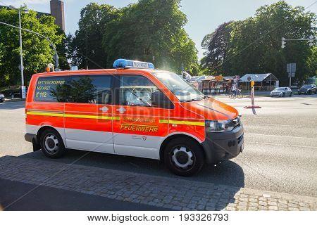 KIEL / GERMANY - JUNE 20 2017: german emergency doctor car from fire department drives on a street.