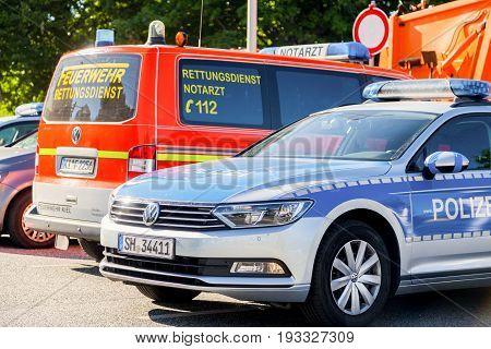 KIEL / GERMANY - JUNE 20 2017: german police and an ambulance car stands on public event Kieler Woche.