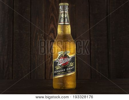 MINSK, BELARUS - JUNE 29, 2017: Miller Genuine Draft Beer on wooden background. Miller is the original cold filtered packaged draft beer, a product of the Miller Brewing Company owned by SABMiller.