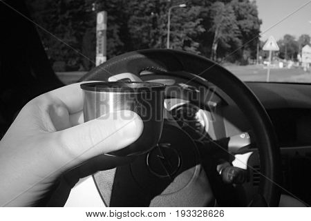 Liberec Czech republic - Juny 10 2017: espresso drinking from thermos in black Opel Astra H car in Chrastavska street leading to center of city Liberec in summer evening