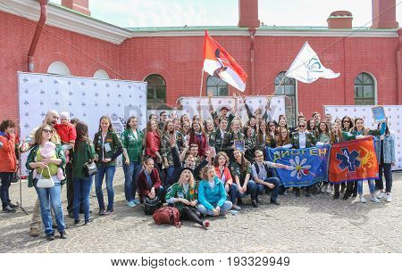 St. Petersburg Russia - 28 May, A student squad with flags posing for a photograph, 28 May, 2017. Famous sightseeing places of St. Petersburg for tourists.