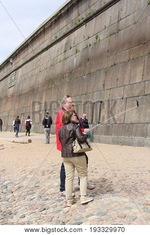 St. Petersburg Russia - 28 May, Selfie at the fortress wall, 28 May, 2017. Famous sightseeing places of St. Petersburg for tourists.