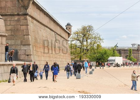 St. Petersburg Russia - 28 May, People walk along the wall of walls, 28 May, 2017. Famous sightseeing places of St. Petersburg for tourists.