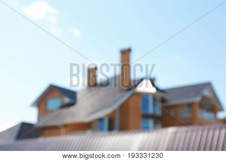 Blurred view of beautiful private house on sunny day