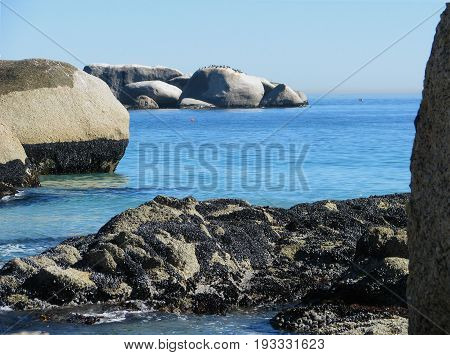 FROM CLIFTON, CAPE TOWN, SOUTH AFRICA, WITH HUGE BOULDERS IN THE FORE GROUND AND THE BACK GROUND 28nfku