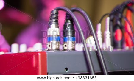 Wires with plugs in the music console .
