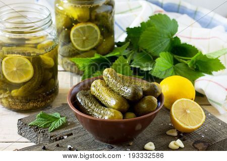 Marinated Cucumbers Gherkins. Pickles Marinated With Lemon And Garlic On The Kitchen Wooden Table.
