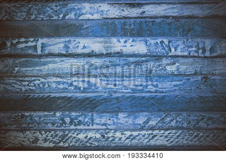 Blue wooden abstract texture. Blue vintage wood background. Abstract texture and background for designers. Macro view of blue wood in vintage style. Blue wood background.
