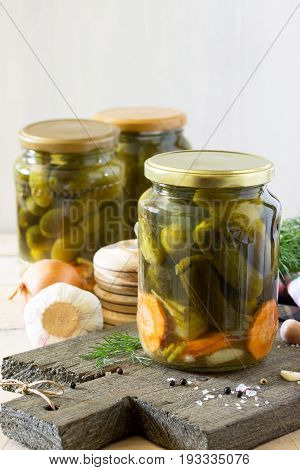 Marinated Cucumbers Gherkins. Marinated Pickles With Garlic On The Kitchen Table.