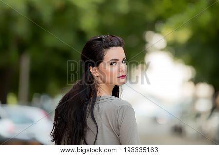 Cute girl posing outdoors and enjoying the summertime.