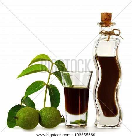 Homemade walnut liqueur isolated on white background