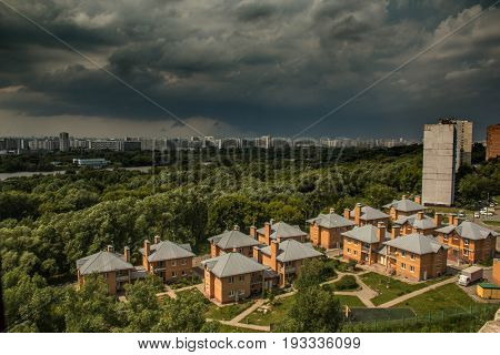 MOSCOW RUSSIA - 30 June 2017: Storm in Moscow. Panorama photo. Kapotnya Moskva Reka Maryno and Brateevo outskirts of UVAO Moscow Russia. Summer hurricane view of city park and Moscow River
