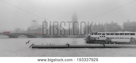 London River Thames Westminster riverscape during foggy weather on a partly de-saturated background