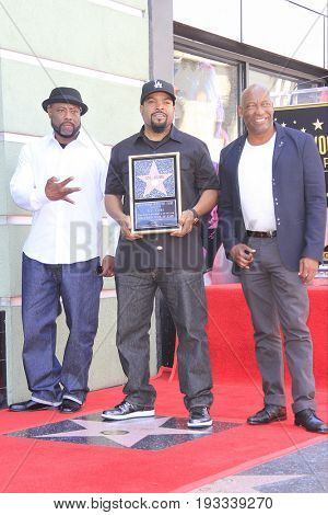 LOS ANGELES - JUN 12: William Loshawn Calhoun Jr aka WC, Ice Cube, John Singleton at a ceremony as Ice Cube is honored with a star on the Hollywood Walk of Fame on June 12, 2017 in Los Angeles, CA