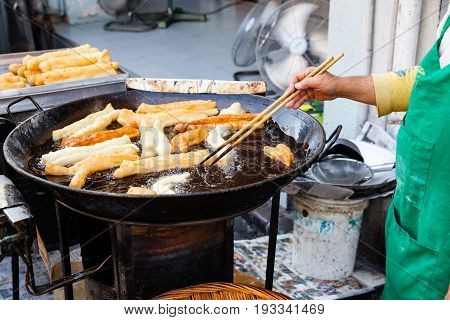 Man Cooks Youtiao At The Street Market