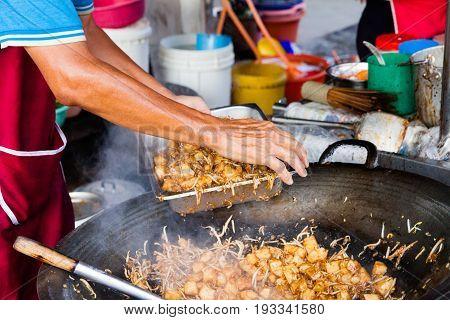 Man Cooks Food At Kimberly Street Food Night Market