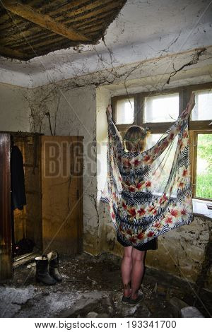 Young Girl In Front Of An Old Window
