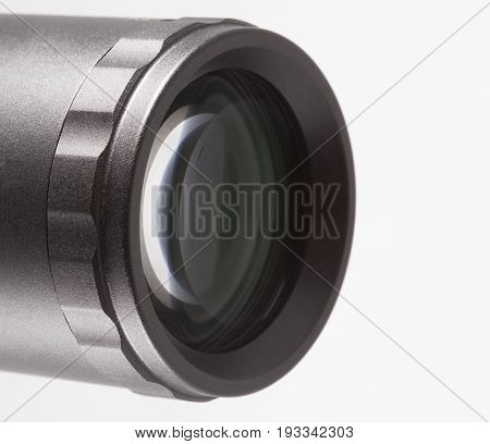 Back lens on a rifle scope isolated on white