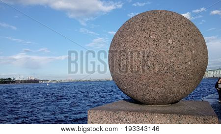 Granite sphere standing on the embarkment of Neva river St. Petersburg Russia