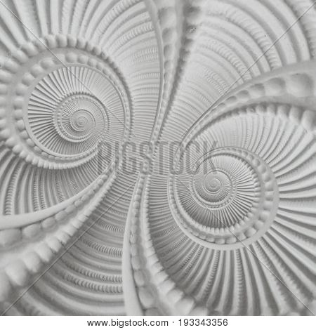 White stucco moulding plasterwork element double spiral abstract fractal pattern background.