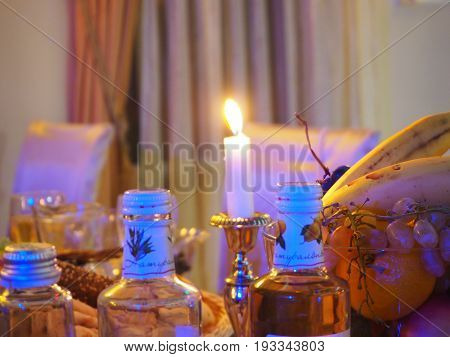 Romantic dinner table with drinks candles and fruits