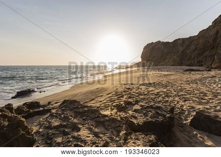 Sunset at secluded Pirates Cove Beach at Point Dume Park in Malibu, California.