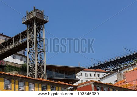 PORTO, PORTUGAL - APRIL 17, 2017: Colorful Porto Ribeira, Unesco site, seeing typical houses and the old public elevator, Elevador da Lada. Porto, Portugal