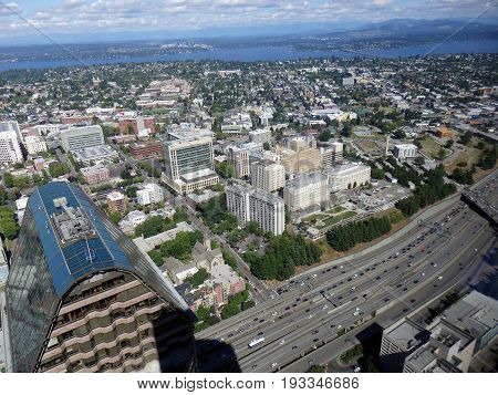 SEATTLE-- JUNE 25: Aerial view of downtown Seattle buildings Lake and Highway on June 25 2016 in Seattle WA.