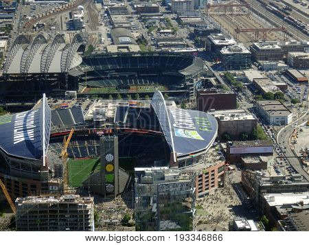 SEATTLE - JUNE 25: Aerial view of CenturyLink with people entering arena train tracks buildings roads and Safeco Field in Seattle in June 25 2015. Home of the Seattle Seahawks (NFL) Mariners (MLB) and Sounders (MLS).