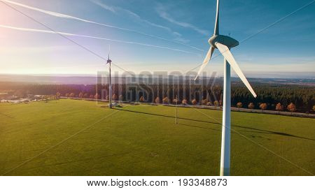 Windmill At Windfarm On A Sunny Summer Day