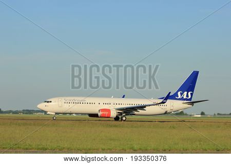 Amsterdam the Netherlands - June 1st 2017: LN-RGH SAS Scandinavian Airlines Boeing 737 taking off from Polderbaan Runway Amsterdam Airport Schiphol