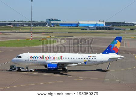 Amsterdam The Netherlands - May 26th 2017: D-ABDB Small Planet Airlines Germany Airbus A320 pulled back from the gate at Schiphol International Airport