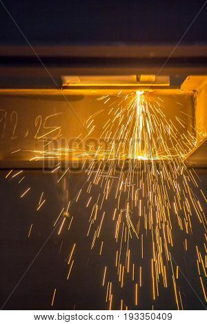close up cutting old steel or welding with fire from gas without protect body